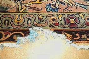 torn rug